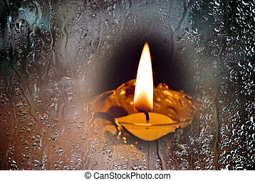 Candle in the rainy window.