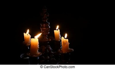 Candle in vintage candlestick - Candles are extinguished in...