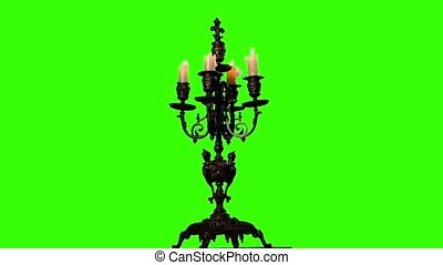 Candles are extinguished in vintage candlestick on black background