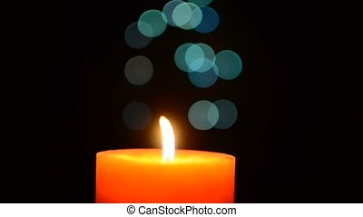Candle is lit, and then goes out. Over bokeh background.