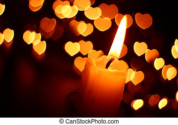 Candle light and hearts in the background