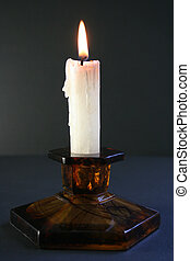 Candle - Light of candle in a dark back ground