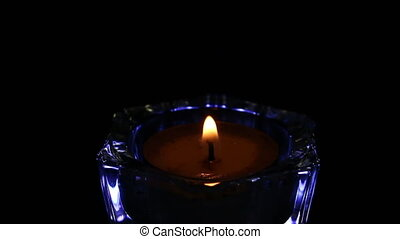 candle light on glass isolated black