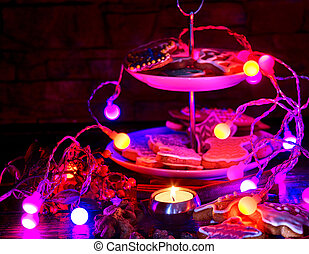 Candle light table with Christmas gingerbread cookies.