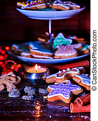 Candle light table with Christmas gingerbread cookies . -...