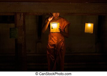 Candle Lighter - A novice monk lights lanterns on the nights...