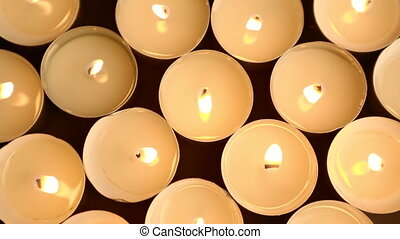 Candle lights on a dark background - Closeup of candle...