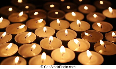 Candle lights on a dark background