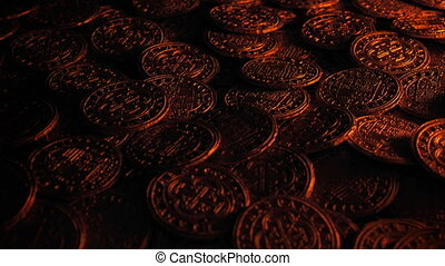Candle Lights Up Treasure Coins - Closeup of old gold coins...