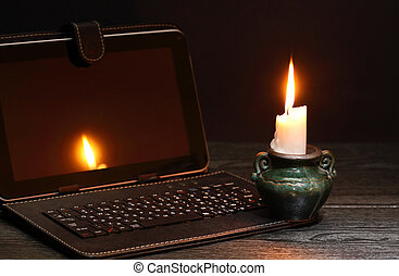 Candle Near Laptop - Blackout concept. Lighting candle near ...