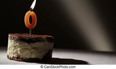 Candle o in tiramisu cake.