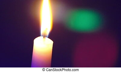 candle on a colored background moving