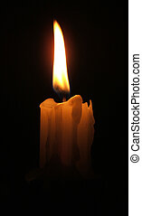 Candle glows from a seamless black background