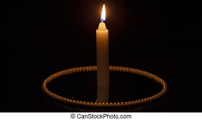 Candle on black