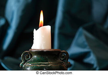 Candle On Dark - One lighting candle in candlestick on dark ...