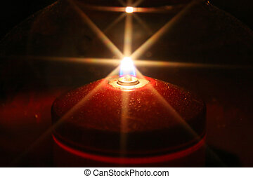 candle silhouette with star shaped light