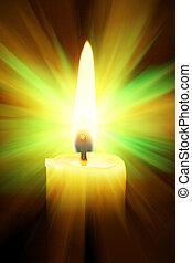 Candle - Single burning burning candle over a black...