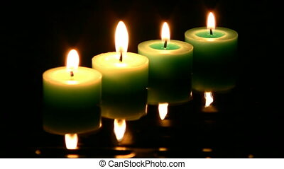 Candle - Four green candle burning