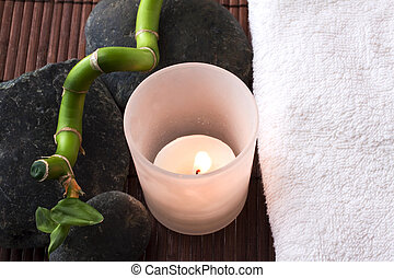Candle, stones and towel