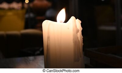 Candle White Big Burning in the Wind Close-up Video 4k. High quality 4k footage