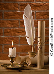 candle with antique writing accessries