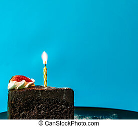 Candle with fire on cake for birthday