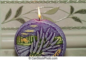 Candle with lavender flowers. Aromatherapy concept
