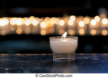 candlelight - burning candle in a church