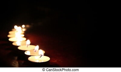 Candlelight  - Little candles lined up light up one by one