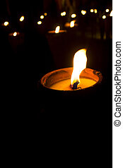 Candlelight - Lighting of candles in the dark