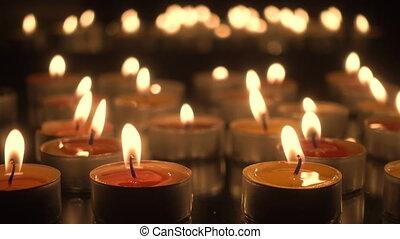 Many burning candles close-up