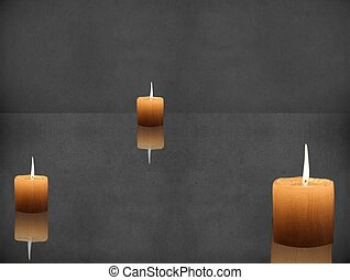 Candlelight on gray black background with reflection