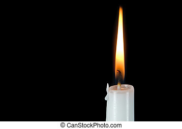 White candle glowing on black background.