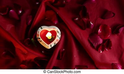 Candlelight with red roses petals, Dolly shot - Candlelight...