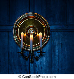 Candles and blue wooden background