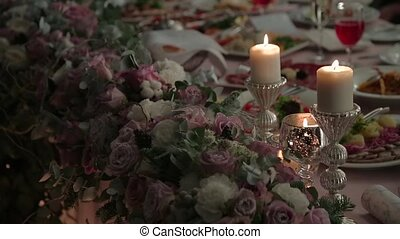Candles and flowers on a festive table