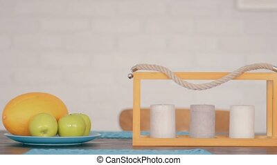Candles and fruits - Three candles and fresh fruits on the...