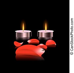 candles and petals - black background and two burning...