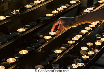 Candles and the hand putting a new candle