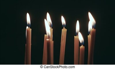 Candles are burning in the spacious room and go out. Black...