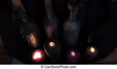Candles are lit in a dark room.