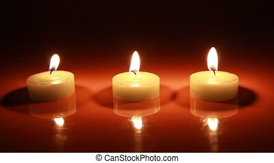 Candles are lit on a backgroung