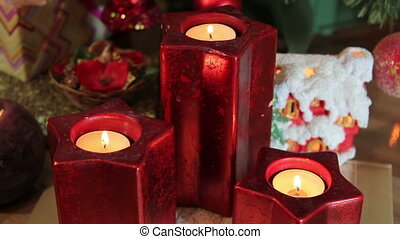 candles around the Christmas tree,gifts