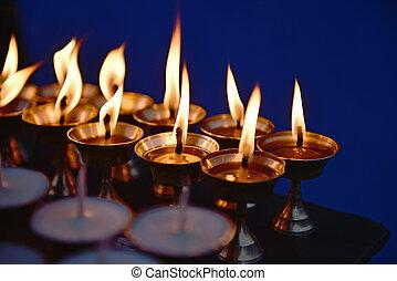 Candles at  Boudha Nath (Bodhnath) stupa  in Kathmandu, Nepal