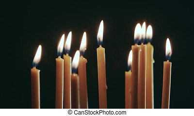Candles burn, a beautiful orange flame, then go out from the...