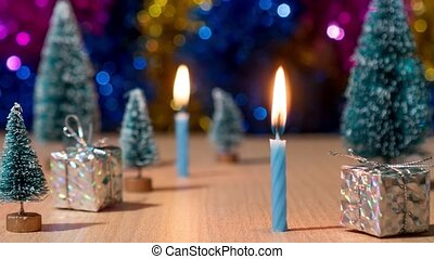 Candles burn in timelapse amid gifts and Christmas trees