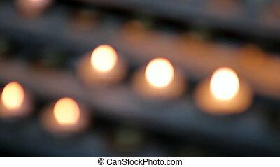 Candles burn near altar