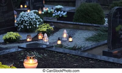 Candles burning at a cemetery during all saints day. 4K -...