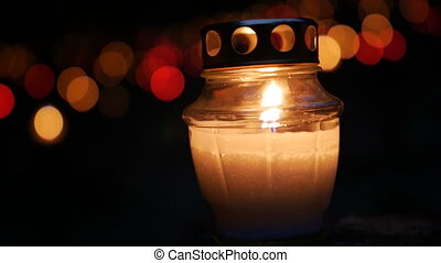 Candles Burning At a Cemetery During All Saints Day. Shallow depth of field.