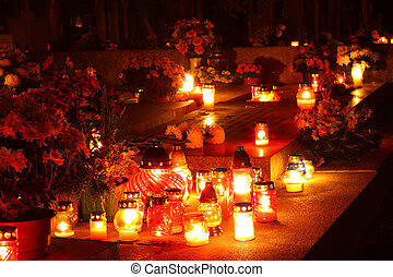 Candles burning at a cemetery - red and yellow candles ...